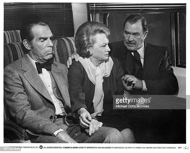 Actor Fred MacMurray actress Olivia de Havilland and actor Ben Johnson on set of the Warner Bros movie 'The Swarm' in 1978