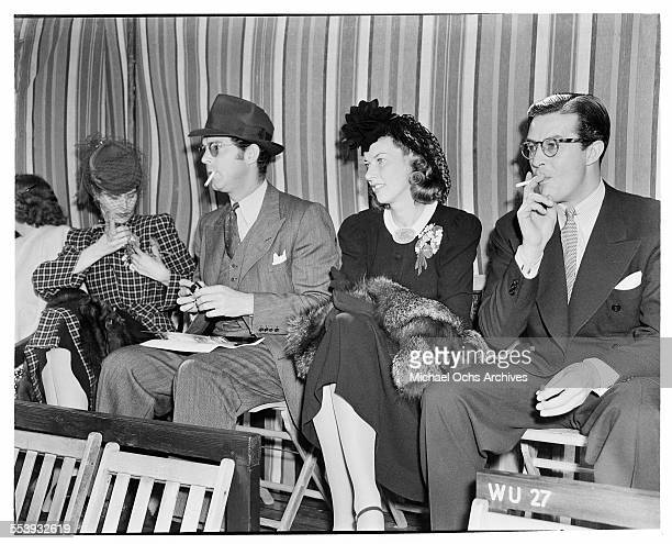 Actor Fred MacMurray sits with Muriel Frances Weber and her husband actor Ray Milland during an event in Los Angeles California
