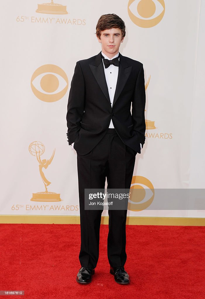 Actor <a gi-track='captionPersonalityLinkClicked' href=/galleries/search?phrase=Freddie+Highmore&family=editorial&specificpeople=210834 ng-click='$event.stopPropagation()'>Freddie Highmore</a> arrives at the 65th Annual Primetime Emmy Awards at Nokia Theatre L.A. Live on September 22, 2013 in Los Angeles, California.