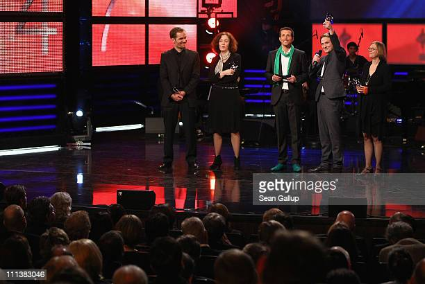 Actor Frederick Lau holds up his award as scriptwriter Christian Zuebert director Hermine Huntegeburth host Helmar Willi Weitzel and Bettina Schmidt...