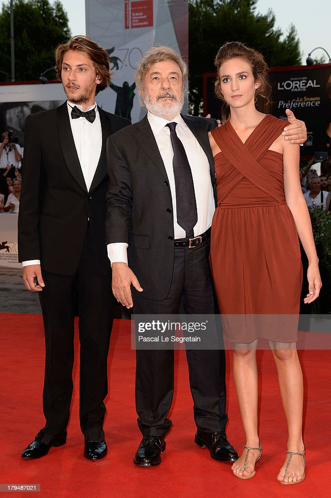 Actor Gabriele Rendina, director <a gi-track='captionPersonalityLinkClicked' href=/galleries/search?phrase=Gianni+Amelio&family=editorial&specificpeople=2868626 ng-click='$event.stopPropagation()'>Gianni Amelio</a> and actress Livia Rossi attend the 'L'Intrepido' Premiere during the 70th Venice International Film Festival at the Palazzo del Cinema on September 4, 2013 in Venice, Italy.