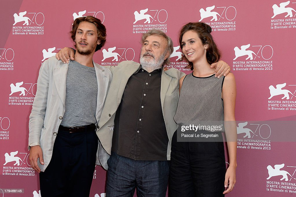 Actor Gabriele Rendina, Livia Rossi, director <a gi-track='captionPersonalityLinkClicked' href=/galleries/search?phrase=Gianni+Amelio&family=editorial&specificpeople=2868626 ng-click='$event.stopPropagation()'>Gianni Amelio</a> attend 'L'Intrepido' Photocall during the 70th Venice International Film Festival at Palazzo del Casino on September 4, 2013 in Venice, Italy.