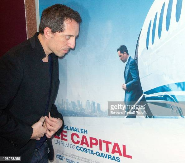 Actor Gad Elmaleh poses by the movie's poster as he attends 'Le Capital' premiere at Gaumont Parnasse on November 12 2012 in Paris France