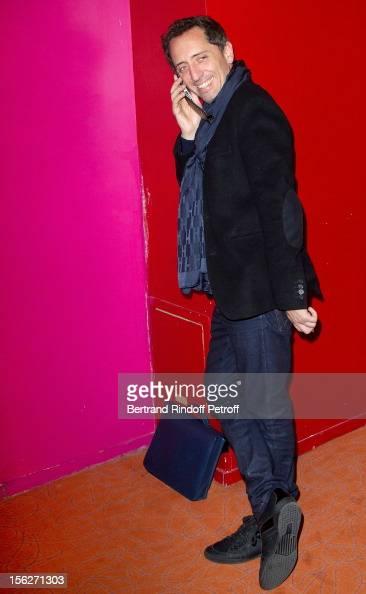 Actor Gad Elmaleh speaks on his mobile phone as he attends 'Le Capital' premiere at Gaumont Parnasse on November 12 2012 in Paris France