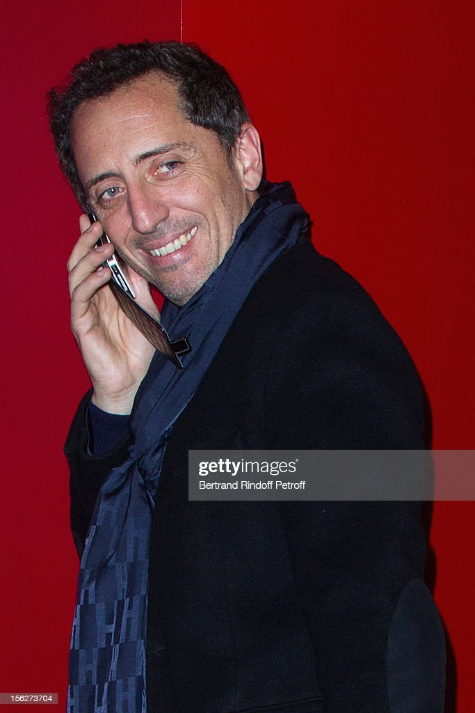 Actor Gad Elmaleh speaks on his mobile phone as he attends 'Le Capital' premiere at Gaumont Parnasse on November 12, 2012 in Paris, France.