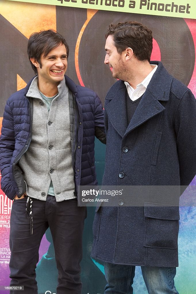 Actor Gael Garcia Bernal (L) and director Pablo Larrain (R) attend the 'No' photocall at the Golem cinema on February 7, 2013 in Madrid, Spain.