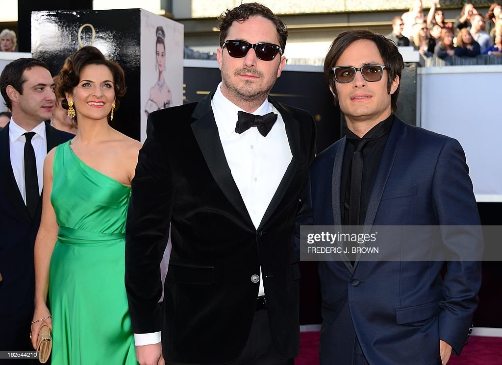 Actor Gael Garcia Bernal arrives with Best Foreign Language Film nominee director Pablo Larraín Matte (C), actress Antonia Zegers and twin-brother Juan de Dios Larrain (L) on the red carpet for the 85th Annual Academy Awards on February 24, 2013 in Hollywood, California.