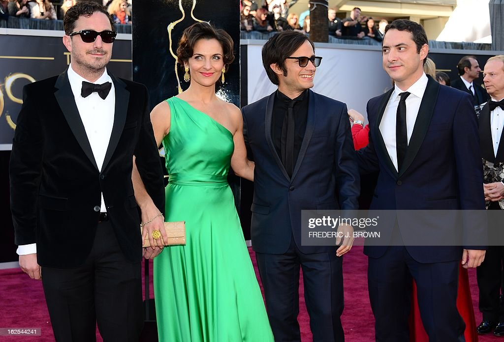 Actor Gael Garcia Bernal arrives with Best Foreign Language Film nominee director Pablo Larraín Matte (L), actress Antonia Zegers and twin-brother Juan de Dios Larrain (L) on the red carpet for the 85th Annual Academy Awards on February 24, 2013 in Hollywood, California.