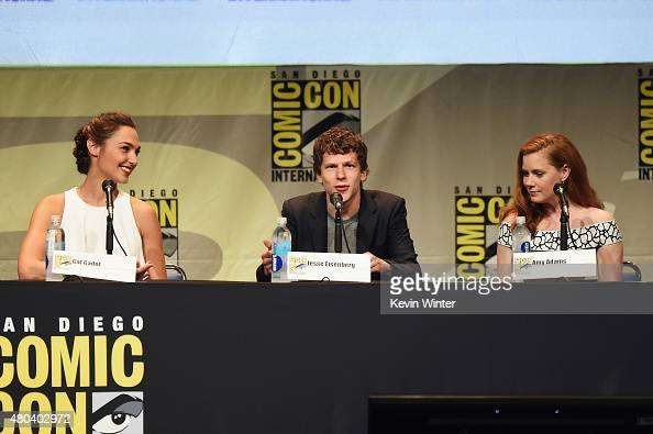 Actor Gal Gadot actor Jesse Eisenberg and actress Amy Adams from 'Batman v Superman Dawn of Justice' attend the Warner Bros presentation during...