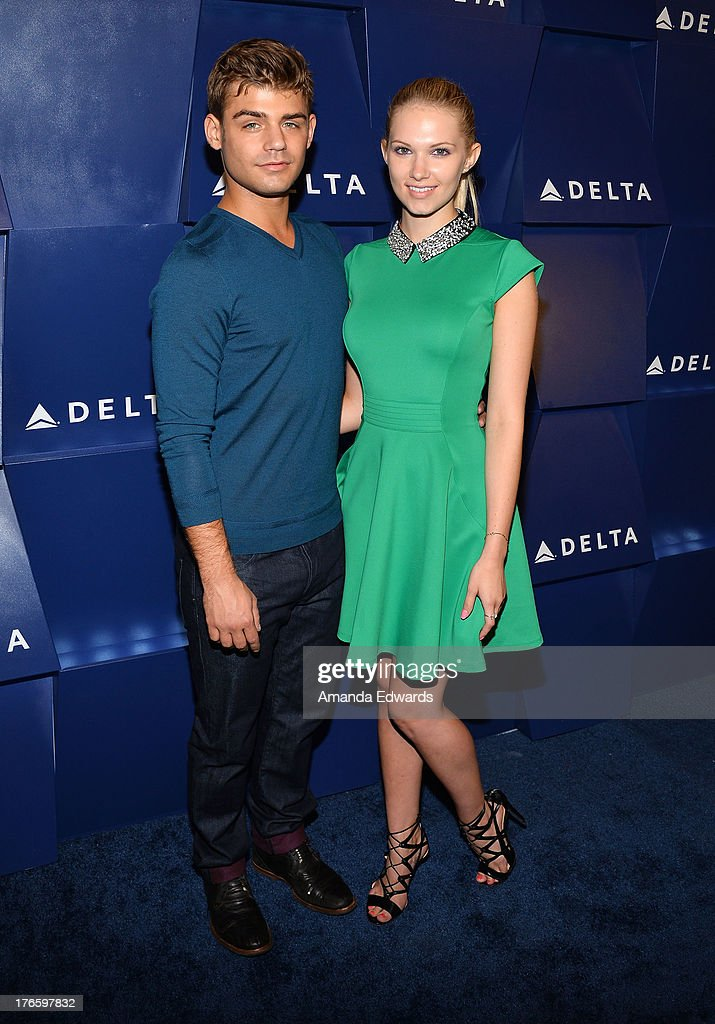 Actor <a gi-track='captionPersonalityLinkClicked' href=/galleries/search?phrase=Garrett+Clayton&family=editorial&specificpeople=9767833 ng-click='$event.stopPropagation()'>Garrett Clayton</a> (L) and actress <a gi-track='captionPersonalityLinkClicked' href=/galleries/search?phrase=Claudia+Lee&family=editorial&specificpeople=6786306 ng-click='$event.stopPropagation()'>Claudia Lee</a> arrive at the Delta Air Lines Summer Celebration at Beverly Grove Drive on August 15, 2013 in Beverly Hills, California.