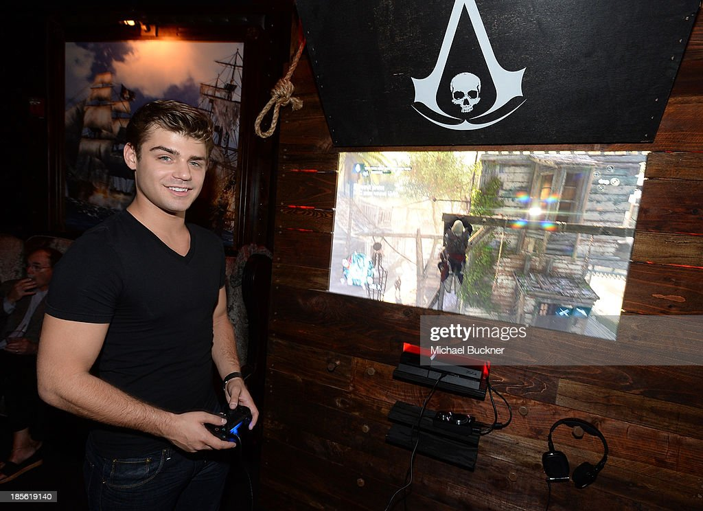 Actor <a gi-track='captionPersonalityLinkClicked' href=/galleries/search?phrase=Garrett+Clayton&family=editorial&specificpeople=9767833 ng-click='$event.stopPropagation()'>Garrett Clayton</a> playing the Sony Playstation 4 at the Assasin's Creed IV Black Flag Launch Party at Greystone Manor Supperclub on October 22, 2013 in West Hollywood, California.