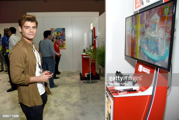 Actor Garrett Clayton plays Super Mario Odyssey at the Nintendo booth at the 2017 E3 Gaming Convention at Los Angeles Convention Center on June 14...