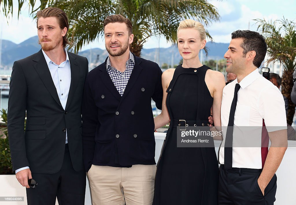 Actor Garrett Hedlund, actor Justin Timberlake, actress Carey Mulligan and actor Oscar Isaac attend the 'Inside Llewyn Davis' photocall during the 66th Annual Cannes Film Festival at the Palais des Festivals on May 19, 2013 in Cannes, France.