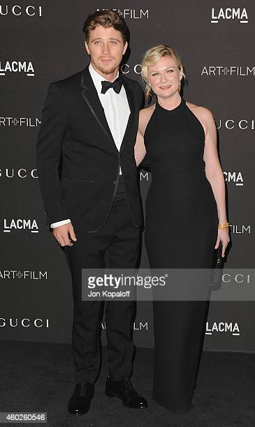 Actor Garrett Hedlund and actress Kirsten Dunst arrive at the 2014 LACMA Art Film Gala Honoring Quentin Tarantino And Barbara Kruger at LACMA on...