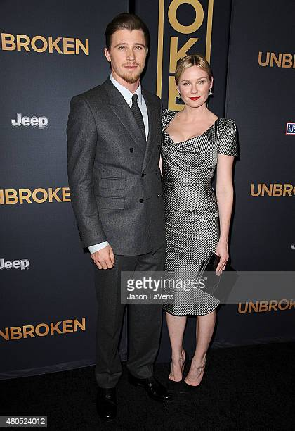 Actor Garrett Hedlund and actress Kirsten Dunst attend the premiere of 'Unbroken' at TCL Chinese Theatre IMAX on December 15 2014 in Hollywood...