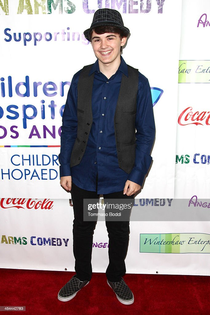 Actor Garrett Palmer attends the 'Up In Arms' comedy fundraiser benefiting Children's Hospital Los Angeles held at Park La Brea Theater on December 8, 2013 in Los Angeles, California.