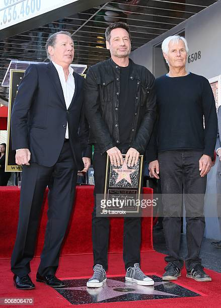 Actor Garry Shandling actor David Duchovny and writer/director Chris Carter attend the star on the Hollywood Walk of Fame ceremony honoring David...