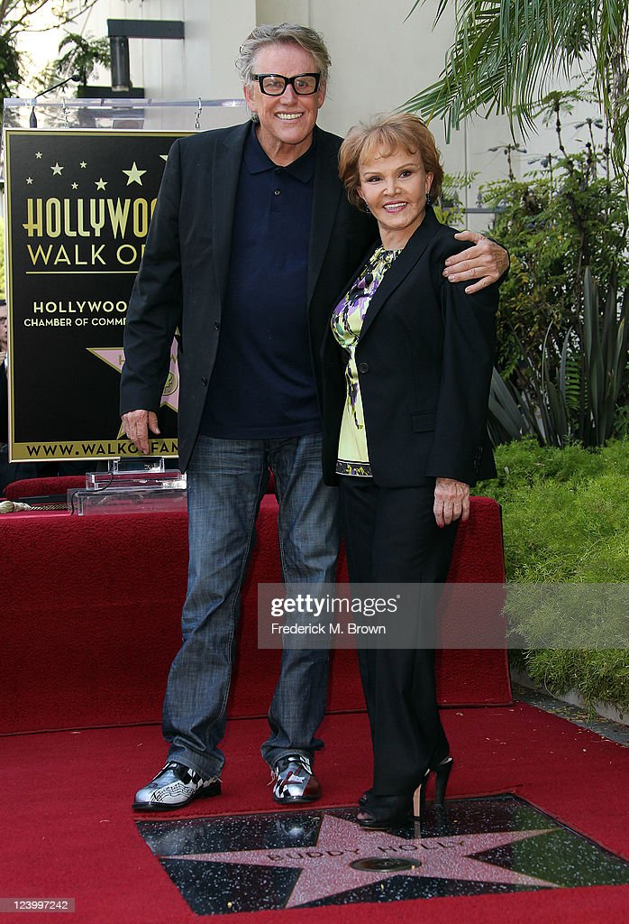 Actor <a gi-track='captionPersonalityLinkClicked' href=/galleries/search?phrase=Gary+Busey&family=editorial&specificpeople=206115 ng-click='$event.stopPropagation()'>Gary Busey</a> (L) and Maria Elena Holly pose for photographers during the ceremony for recording artist Buddy Holly's posthumous star on the Hollywood Walk of Fame on September 7, 2011 in Hollywood, California.