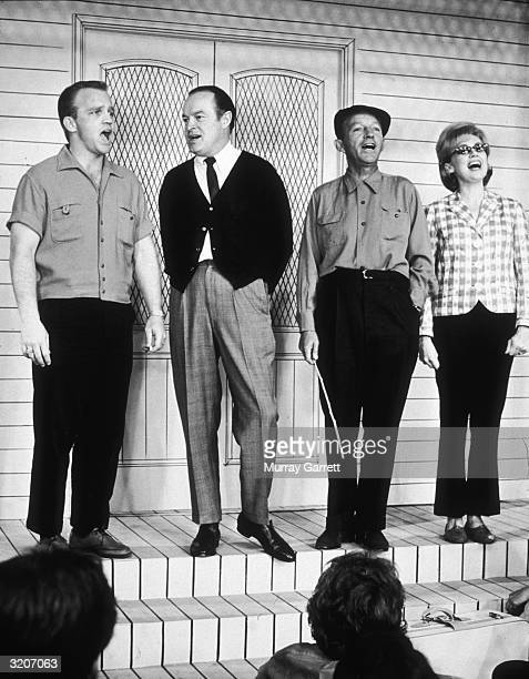 Actor Gary Crosby comedian Bob Hope singer and actor Bing Crosby and actor Edie Adams sing a number on stage for a Bob Hope television special Los...