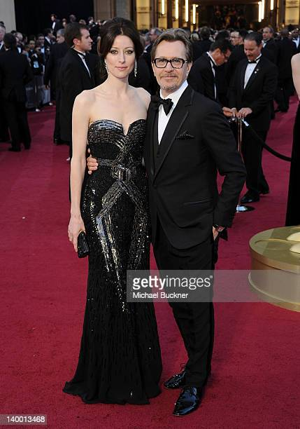 Actor Gary Oldman and Alexandra Edenborough arrives at the 84th Annual Academy Awards held at the Hollywood Highland Center on February 26 2012 in...