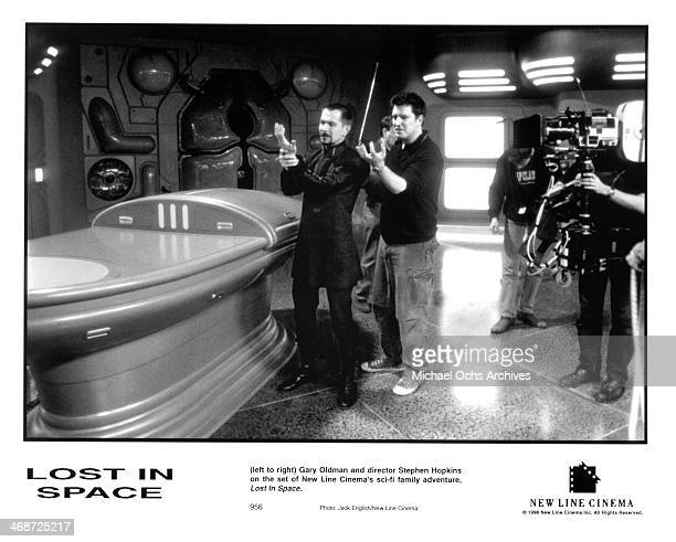 Actor Gary Oldman and director Stephen Hopkins on set of the New Line Cinema movie ' Lost in Space ' circa 1998