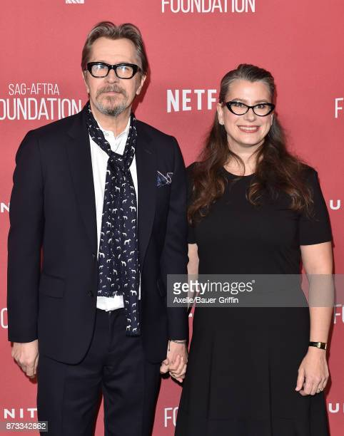 Actor Gary Oldman and Gisele Schmidt arrive at SAGAFTRA Foundation Patron of the Artists Awards 2017 on November 9 2017 in Beverly Hills California
