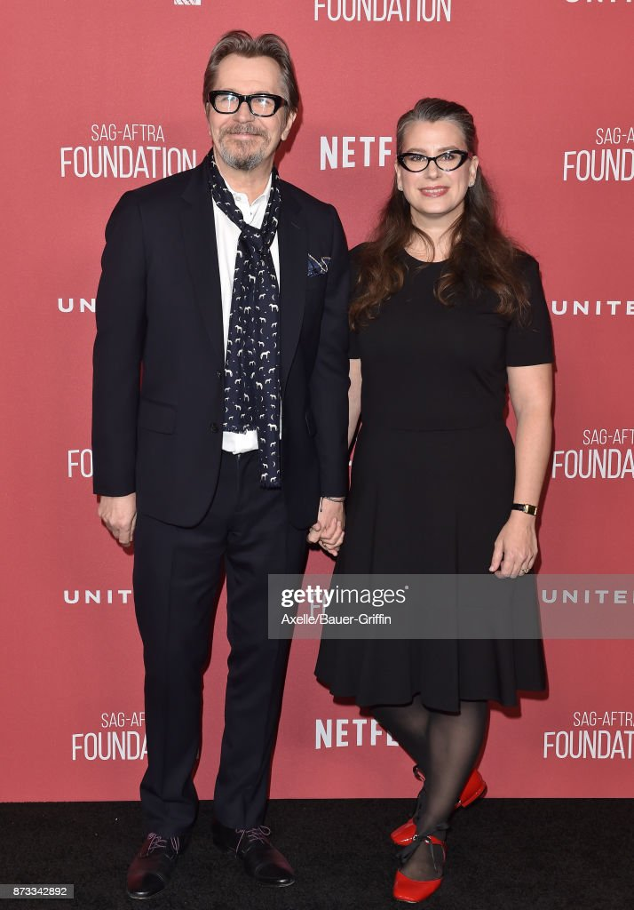 Actor Gary Oldman and Gisele Schmidt arrive at SAG-AFTRA Foundation Patron of the Artists Awards 2017 on November 9, 2017 in Beverly Hills, California.