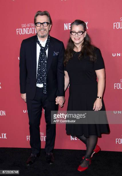 Actor Gary Oldman and Gisele Schmidt attend the SAGAFTRA Foundations Patron of the Artists Awards on November 9 in Beverly Hills California / AFP...