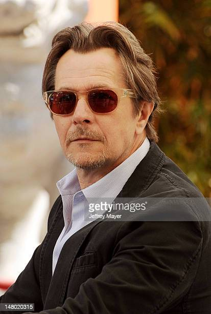 Actor Gary Oldman attends Christopher Nolan hand and footprint ceremony at Grauman's Chinese Theatre on July 7 2012 in Hollywood California