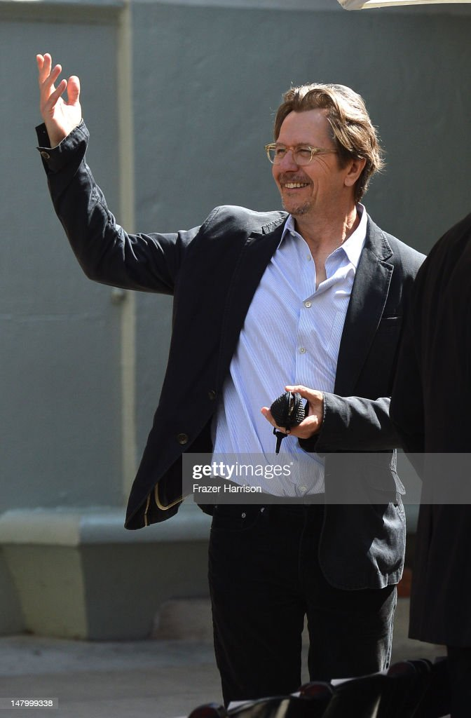 Actor <a gi-track='captionPersonalityLinkClicked' href=/galleries/search?phrase=Gary+Oldman&family=editorial&specificpeople=213839 ng-click='$event.stopPropagation()'>Gary Oldman</a> attends the Hand and Footprint Ceremony for Director, Writer, Producer Christopher Nolan, at Grauman's Chinese Theatre on July 7, 2012 in Hollywood, California.