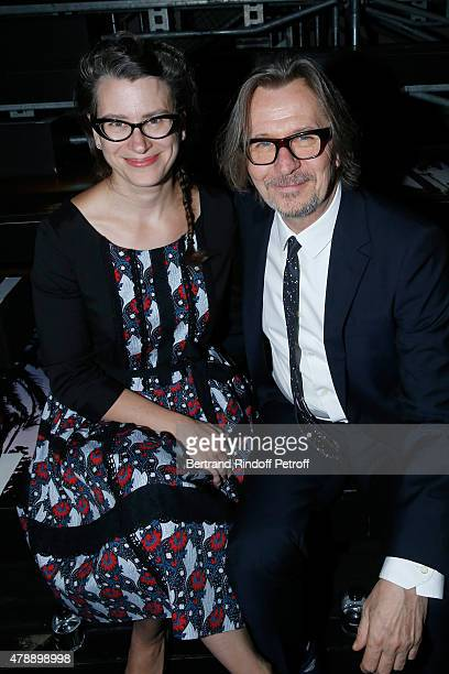 Actor Gary Oldman with his wife Gisele Schmidt attend the Saint Laurent Menswear Spring/Summer 2016 show as part of Paris Fashion Week on June 28...