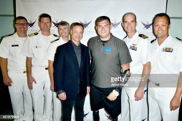 Actor Gary Sinise and Travis Mills attend Gary Sinise Foundation's 'Travis A Soldier's Story' benefit screening at Village Theatre Coronado on July 8...