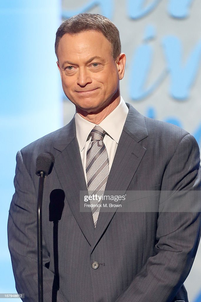 Actor <a gi-track='captionPersonalityLinkClicked' href=/galleries/search?phrase=Gary+Sinise&family=editorial&specificpeople=208981 ng-click='$event.stopPropagation()'>Gary Sinise</a> onstage at the American Giving Awards presented by Chase held at the Pasadena Civic Auditorium on December 7, 2012 in Pasadena, California.