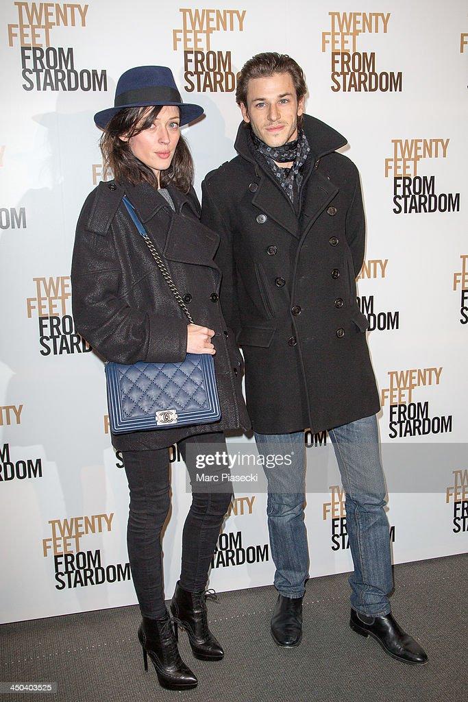 Actor Gaspard Ulliel and friend Gaelle attend the 'Twenty feet from stardom' Paris premiere at Cinema UGC Normandie on November 18, 2013 in Paris, France.