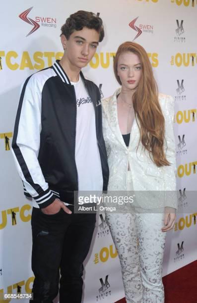 Actor Gavin Casalegno and model/dancer Larsen Thompson arrive for the Premiere Of Swen Group's 'The Outcasts' held at Landmark Regent on April 13...