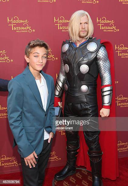 Actor Gavin Casalegno poses alongside a Madame Tussauds Hollywood MARVEL wax figure during the 'Guardians of The Galaxy' premiere at the Dolby...