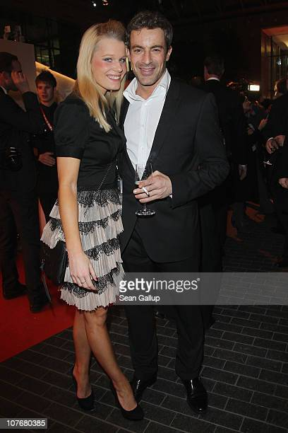Actor Gedeon Burkhard and his girlfriend Annika Bohrmann attend the 'Ein Herz Fuer Kinder' charity gala at Axel Springer Haus on December 18 2010 in...