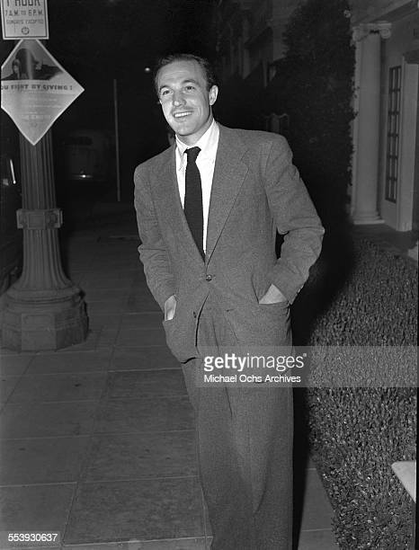 Actor Gene Kelly poses on a street in Los Angeles California