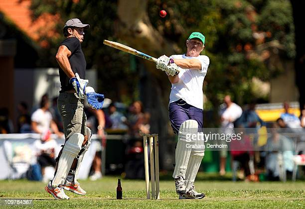 Actor Geoff Morrell of team Veg Out narrowly misses former AFL player Wayne Carey as he bats during the 'Batting for the Battlers' Celebrity Charity...