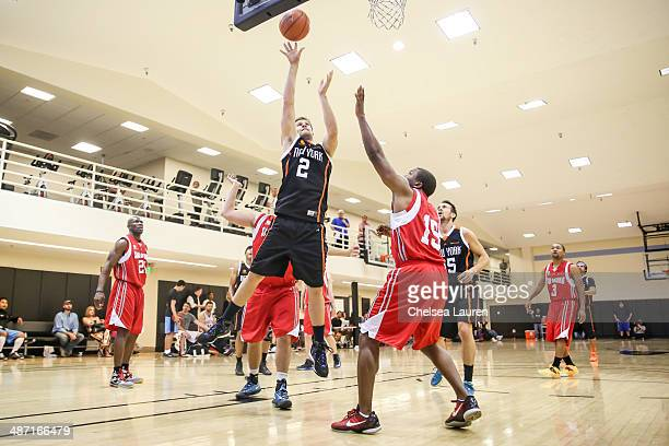 Actor Geoff Stults plays during the ELeague celebrity basketball playoffs at Equinox Sports Club West LA on April 27 2014 in Los Angeles California