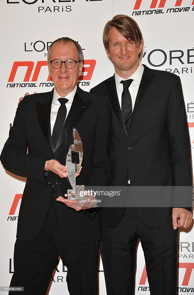 Actor Geoffery Rush and director Tom Hooper pose with the award for Best Drama in the press room at the L'Oreal National Movie Awards 2011 at Wembley...