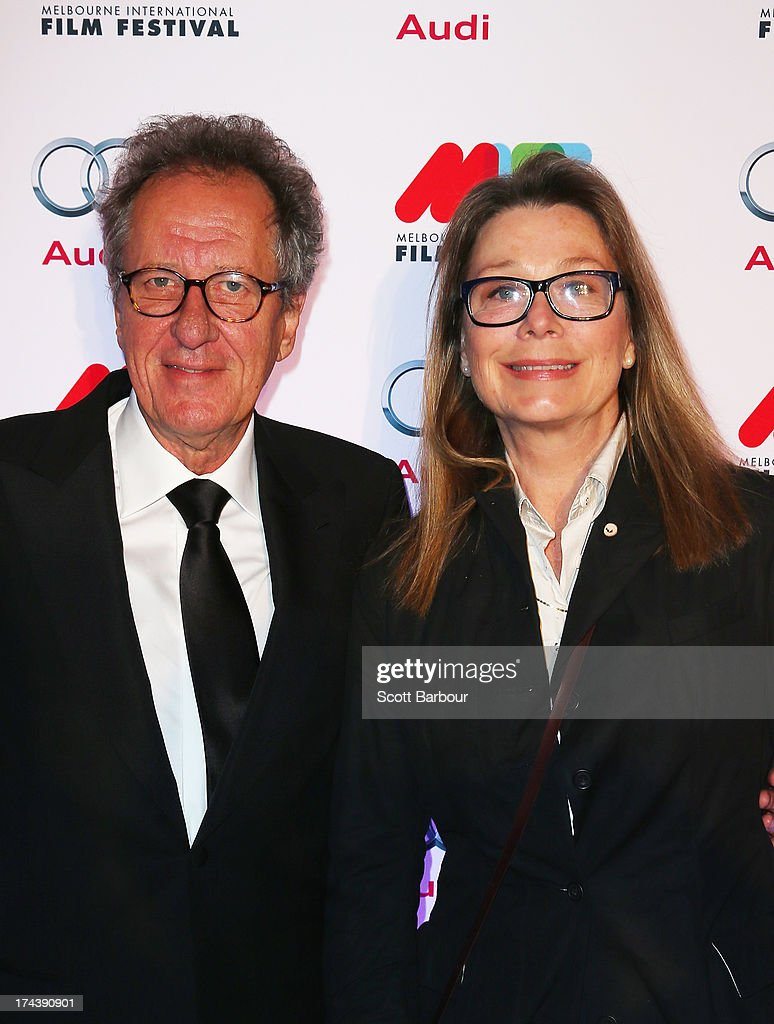 Actor <a gi-track='captionPersonalityLinkClicked' href=/galleries/search?phrase=Geoffrey+Rush&family=editorial&specificpeople=201849 ng-click='$event.stopPropagation()'>Geoffrey Rush</a> (L) and his wife, actress Jane Menelaus arrive at the Australian premiere of 'I'm So Excited' on opening night of the Melbourn International Film Festival at Hamer Hall on July 25, 2013 in Melbourne, Australia.