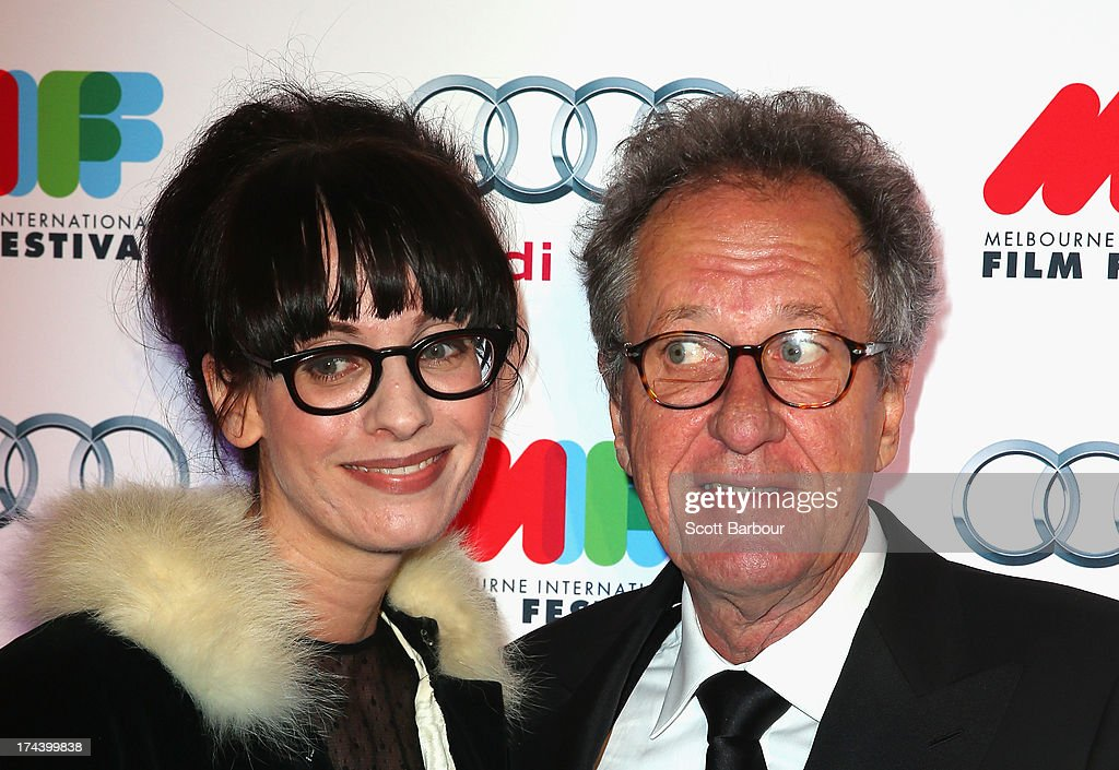 Actor <a gi-track='captionPersonalityLinkClicked' href=/galleries/search?phrase=Geoffrey+Rush&family=editorial&specificpeople=201849 ng-click='$event.stopPropagation()'>Geoffrey Rush</a> and Michelle Carey, Artistic Director of the 2013 Melbourne International Film Festival arrive at the Australian premiere of 'I'm So Excited' on opening night of the Melbourn International Film Festival at Hamer Hall on July 25, 2013 in Melbourne, Australia.