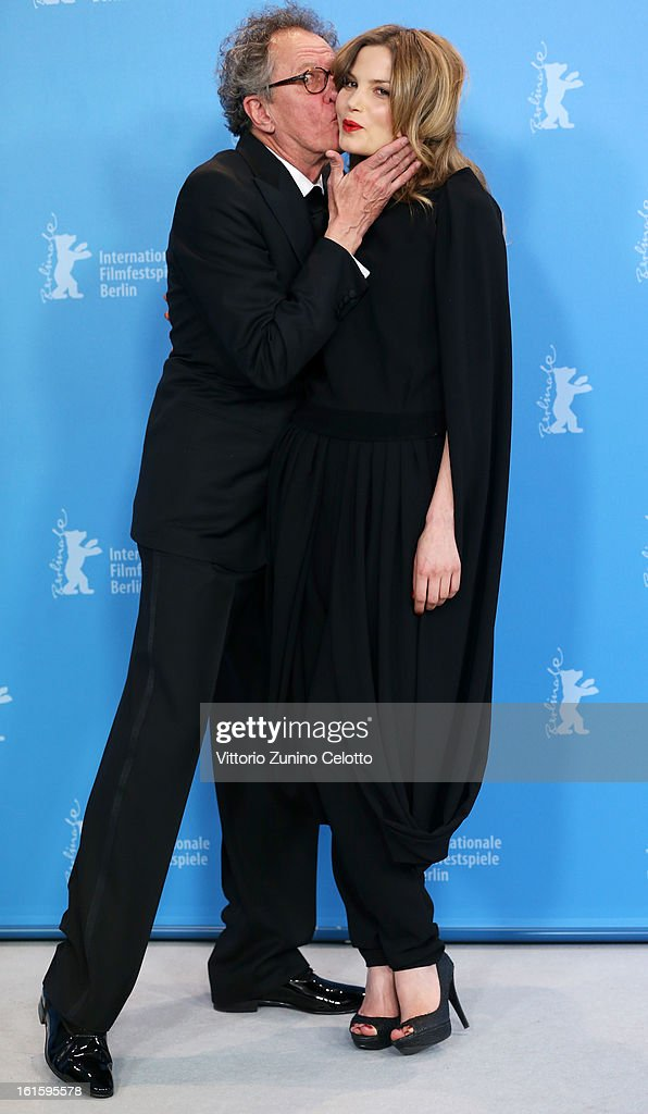 Actor <a gi-track='captionPersonalityLinkClicked' href=/galleries/search?phrase=Geoffrey+Rush&family=editorial&specificpeople=201849 ng-click='$event.stopPropagation()'>Geoffrey Rush</a> kisses actress Sylvia Hoeks as they attend the 'The Best Offer' Photocall during the 63rd Berlinale International Film Festival at the Grand Hyatt Hotel on February 12, 2013 in Berlin, Germany.
