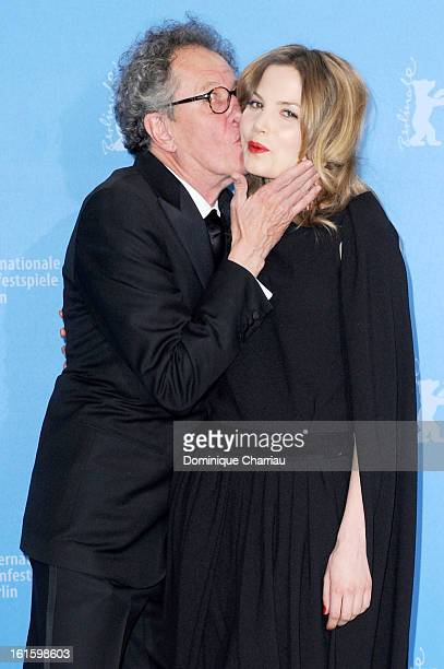 Actor Geoffrey Rush kisses actress Sylvia Hoeks as they attend 'The Best Offer' Photocall during the 63rd Berlinale International Film Festival at...