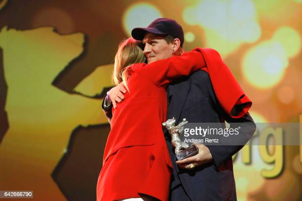 Actor Georg Friedrich speaks on stage as he receives Silver Bear for Best Actor Award for the movie 'Bright Nights' from Julia Jentsch during the...