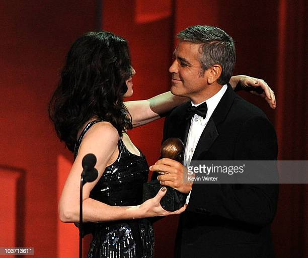 Actor George Clooney accepts the Bob Hope Humanitarian award from actress Julianna Margulies onstage at the 62nd Annual Primetime Emmy Awards held at...