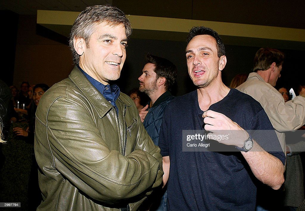 Actor <a gi-track='captionPersonalityLinkClicked' href=/galleries/search?phrase=George+Clooney&family=editorial&specificpeople=202529 ng-click='$event.stopPropagation()'>George Clooney</a> (l) and Actor/Director Hank Azaria (r) talk before his short film 'Nobody's Perfect' at the Writers Guild February 19, 2004 in Los Angeles, California.