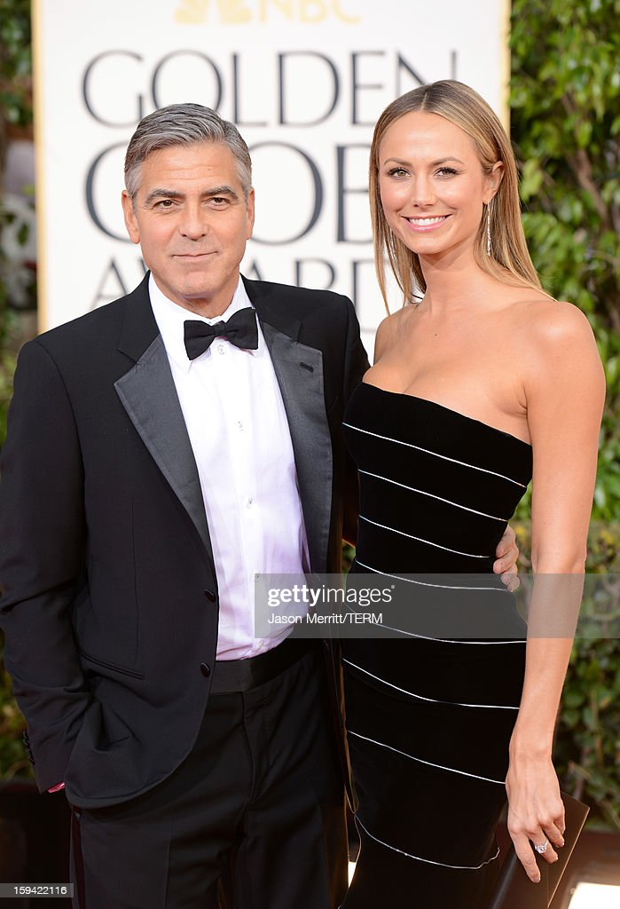 Actor George Clooney (L) and actress Stacy Keibler arrive at the 70th Annual Golden Globe Awards held at The Beverly Hilton Hotel on January 13, 2013 in Beverly Hills, California.
