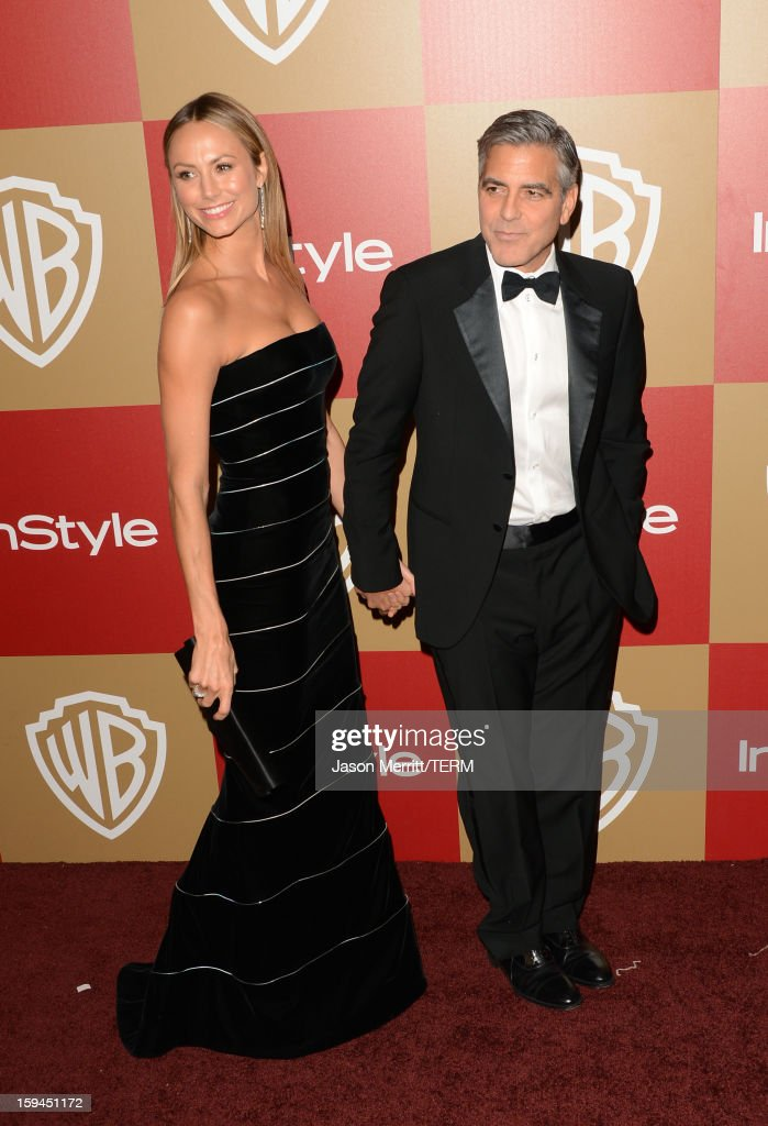 Actor George Clooney (R) and actress Stacy Keibler attend the 14th Annual Warner Bros. And InStyle Golden Globe Awards After Party held at the Oasis Courtyard at the Beverly Hilton Hotel on January 13, 2013 in Beverly Hills, California.